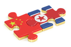 China and North Korea puzzles from flags, 3D rendering Stock Image