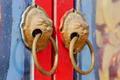 China opens doors. Chinese art opened doors An animal face Royalty Free Stock Photo