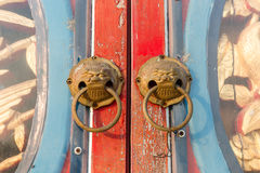 China opens doors. Chinese art opened doors An animal face Royalty Free Stock Image