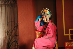 China opera actress sit in a chair Stock Image