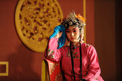 China opera actress sit in a chair Stock Photo