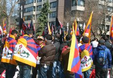 China Out of Tibet. A group of demonstrators protesting China's occupation outside the Chinese Embassy in Toronto, Ontario, Canada on March 28, 2009 Royalty Free Stock Images