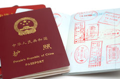 China passport. It is a new version passport of People's Republic of China. isolated. with a opening page, with Stamps Royalty Free Stock Images