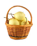 China pears in brown wicker basket isolated Royalty Free Stock Photos