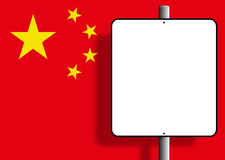 China people's Republic Flag Sign. Flag of the people's republic of China under a blank sign nailed to a post Royalty Free Stock Photo