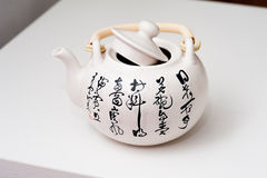 With the China poetry pattern teapot Royalty Free Stock Photos