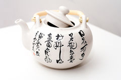 With the China poetry pattern teapot Royalty Free Stock Photo