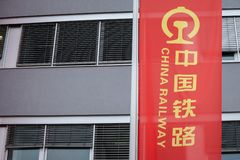 China Railway logo on a flag sign in front of their office for Serbia. Also known as CR, it is the railway operator of China stock images