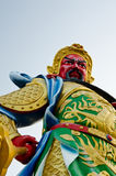 China Red Gods face. Chinese statues on blue background Royalty Free Stock Image