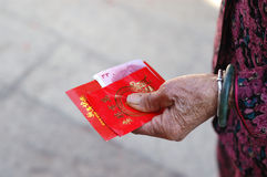 China red packets. It is china red packets in an old woman hand, in Chinese new year, the old man will put some money in the red packets, and give it to young Stock Image