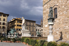 Italy. Florence city streets. Fountain of Neptune in Piazza della Signoria. Piazza della Signoria is an L-shaped square in front of the Palazzo Vecchio in Royalty Free Stock Images