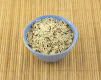 Rice in bowl on mat. China rise in blue bowl on brown straw mat closeup royalty free stock photos