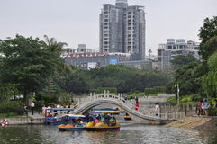 China's ancient arch bridge. Across China ancient arch bridge on the surface of the lake and the modern skyscrapers stands in stark contrast Royalty Free Stock Photos