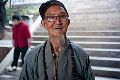 China's ethnic minorities, the Yi old lady Stock Images