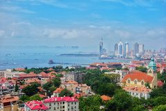 Cityscape. Red-tile roofs shaded in trees are a scenic feature of Qingdao Royalty Free Stock Photos