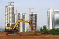 China's property sector. An excavator worker at work on the construction site in china stock image
