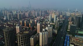 China`s rapidly growing economy and real estate development. Aerial view on Shanghai with urban residential buildings, elevated road and the financial district stock video