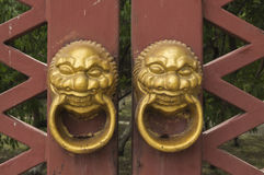 China's traditional wooden door knocker. First, commonly known as knocker. Base knocker first is precise, spread, spread the first title ring is a complete door Stock Image