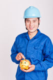China's  workers holding a piggy bank Royalty Free Stock Image