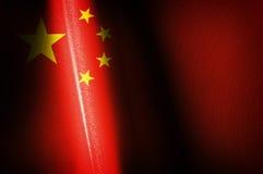 China señala imágenes por medio de una bandera Imagen de archivo