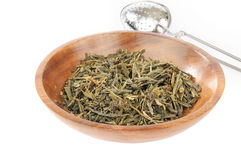 China Sencha Tea. Whole leaf organic China Sencha tea in a bowl with an infuser Stock Photos
