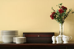 China Service on Buffet. China place settings on buffet with vase and roses Royalty Free Stock Image