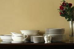 China Service on Buffet. China place settings on buffet with vase and roses Stock Photo