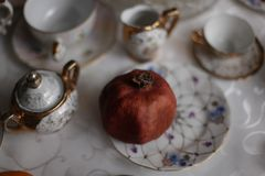 China set with fruits on the table stock photography