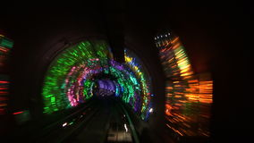 China, Shanghai, The Bund, Bund sightseeing tunnel, slow shutter speed. The Bund sightseeing tunnel goes under the Huangpu River, slow shutter speed stock footage