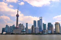 China Shanghai Pudong district under blue sky. Modern business buildings and oriental pearl tower, as landmark in shanghai Pudong Lujiazui center district, shown Stock Images