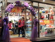 China shoes and purses shop Christmas decorations sales. A shop of boots, shoes and purses for women in Hefei, China decorated with Santa Claus and Christmas Royalty Free Stock Images