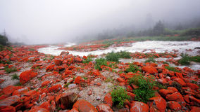 China sichuan kangding yajiageng red rock beach. Red rock beach is located in the west of china, near kangding county, the river rapids is all covered red stock image