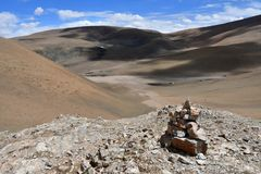 China, small pyramid of stones on the Tibetan plateau.  stock image
