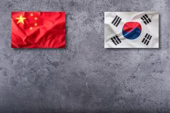 China and South korea flag on concrete background.  royalty free stock image