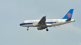 China Southern Airbus A320 landing at Changi Airport Stock Image