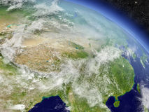 China from space. China with surrounding region as seen from Earth's orbit in space. 3D illustration with highly detailed realistic planet surface and clouds in vector illustration