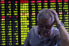 China stock market crash. An investor is looking at the screen showing stock market crash in China in 2014 Stock Image
