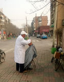 China street barber. Welcomed by seniors Nankai Tianjin China photoed on february 20th 2014 Royalty Free Stock Photo