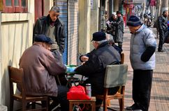 China street scene with mahjong game Royalty Free Stock Photography