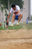 China: Student Track and Field Games / long jump Stock Image