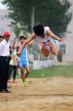 China: Student Track and Field Games / long jump Stock Photo