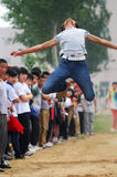 China: Student Track and Field Games / long jump royalty free stock photography