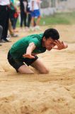 China: Student Track and Field Games / long jump Stock Photography