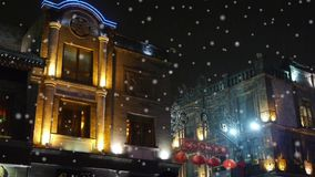 China 1930 style building in night,falling snowflake. stock video footage