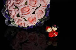 China style Wedding Doll and a bouquet of flowers Royalty Free Stock Photography