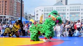 China symbol dancing during kids sport festival, Kiev, Ukraine, stock video