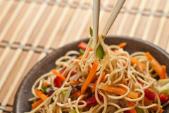 China tasty noodles with vegetables. Royalty Free Stock Image