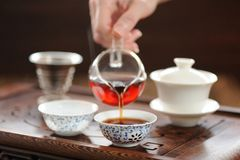 China tea ceremony with puerh tea brewing in haiwan Stock Photos