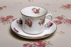 China Tea Cup. A china tea cup on vintage floral background Stock Photography