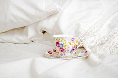 China tea cup on bed Stock Image